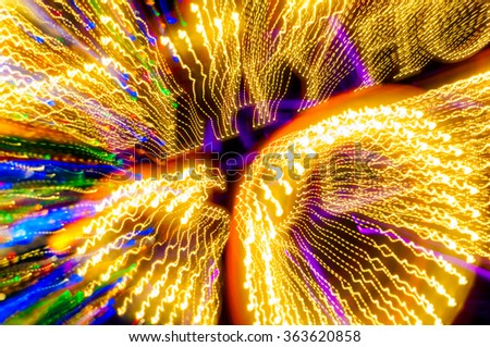 Lights of an illuminated theater billboard appear to stream in supercharged motion due to lens zoom - stock photo