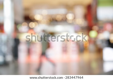 Lights of duty free shop in airport - defocused blured background - stock photo