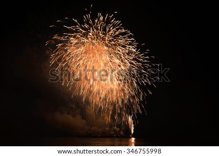 lights of fireworks at night. - stock photo