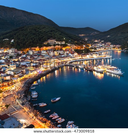 Lights of Parga Greek village by night, Greece, Ionian Islands