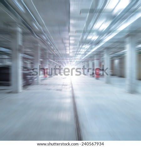 Lights of the moving fast car in the underground parking. - stock photo