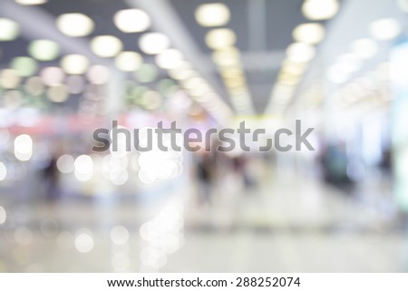 Lights of waiting room in airport out of focus  - bokeh background - stock photo
