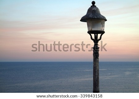LIGHTS OFF - LAMP POST WITH THE EFFECTS OF SALT WATER - stock photo
