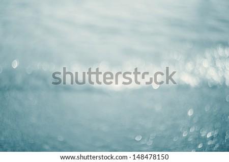 Lights on blue background.Waves.Underwater. - stock photo