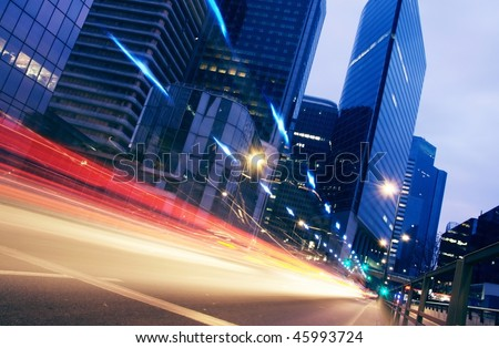 lights trails from cars in business centre-4 - stock photo