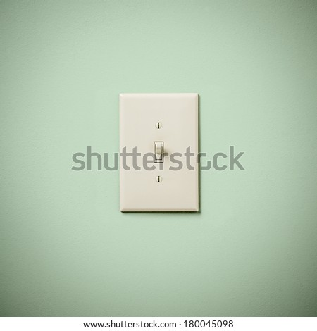 Lightswitch on Blue Green Aqua Teal  Wall On - stock photo