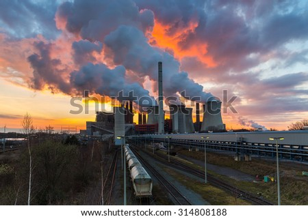 Lignite Power Plant ot sunset with cloudy sky in neurath, germany - stock photo