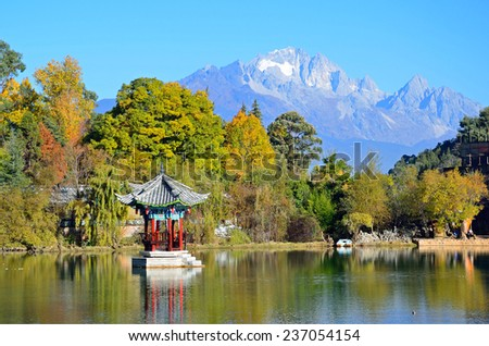 LIJIANG, CHINA - NOVEMBER 27, 2014: Black Dragon Pool is a pond in the scenic Jade Spring Park. It was built in 1737 during the Qing Dynasty. - stock photo