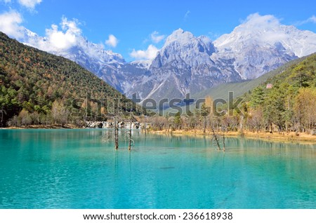 LIJIANG, CHINA � NOVEMBER 28, 2014: Blue Moon Valley is in Yulong snow mountain scenic area.Jade Snow Mountain is the sacred mountain for Naxi ethnic minority.  - stock photo