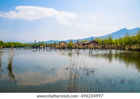 Lijiang Lashi Lake Wetlands is a national natural scenic spot near the city of Lijiang,China. The tourist activities there include horse riding, bird watching, boat ride and fishing.