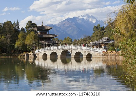 Lijiang old town and Jade Dragon Snow Mountain in China - stock photo