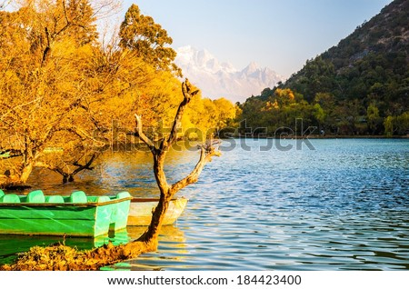 Lijiang old town scene-Black Dragon Pool Park. . In the there, you can see Jade Dragon Snow Mountain. - stock photo