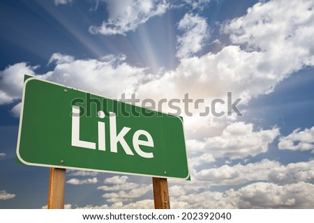 Like Green Road Sign with Dramatic Clouds and Sky. - stock photo