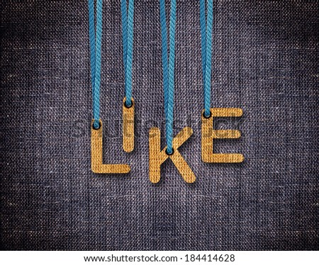 Like Letters hanging strings with blue sackcloth background. - stock photo
