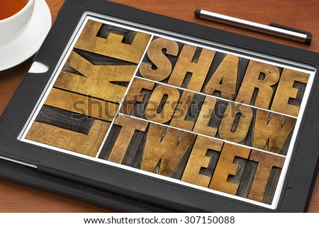 like, share, tweet, follow words-- social media and networking concept - text in letterpress wood printing blocks on a digital tablet with a cup of coffee - stock photo