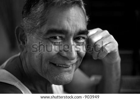 Likeable loving Hispanic grandfather - stock photo