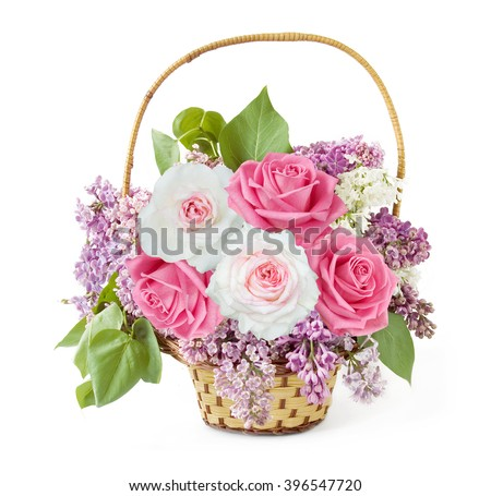 Lilac and roses bunch in basket isolated on white background - stock photo