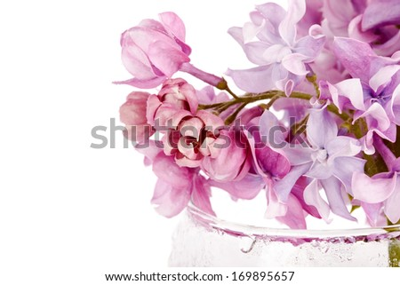 Lilac branch in a glass. Lilac flowers. Lilac bouquet.