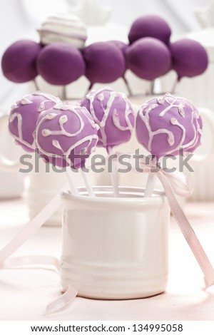 Lilac cake pops decorated lavishly decorated with icing. Selective focus. - stock photo