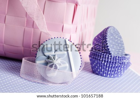 lilac flower cupcake with empty cups - stock photo