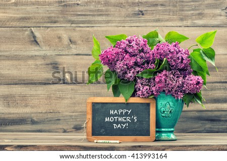 Lilac flowers and vintage blackboard with sample text Happy Mothers Day! Vintage style toned picture. Mother's Day greetings card. Vintage still life. Mother's day. Mothers Day gift. Mothers Day - stock photo