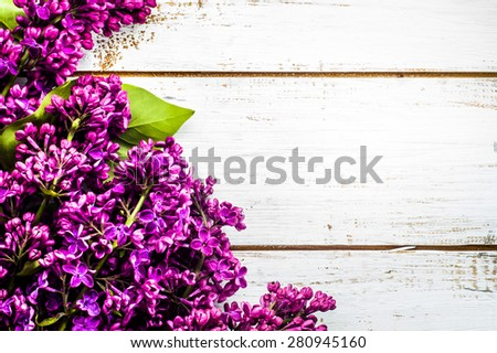 Lilac flowers on wooden planks background useful as greetings card, invitation cards, wedding invitation and postcards with place for text. - stock photo