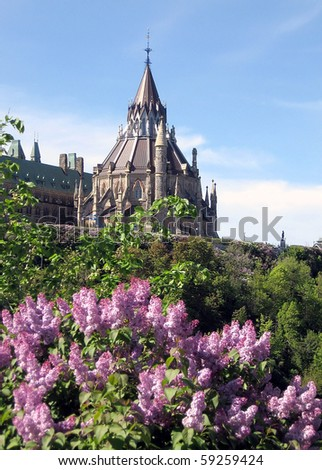 Lilac on a background of Library of Parliament May spring in Ottawa, Canada - stock photo