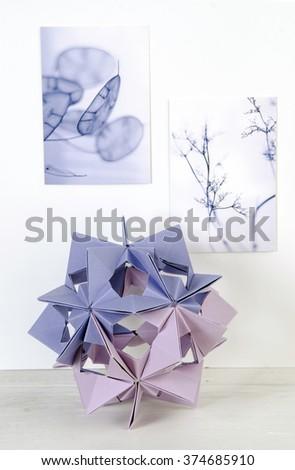 Lilac Origami Kusudama balloon interior decoration on white shelf - stock photo