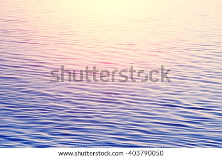 Lilac water with ripples.Toned - stock photo
