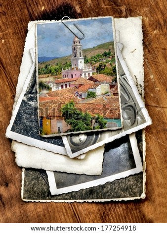 lile of old vintage photographs with on top a colorful image from the colonial village of Trinidad , Cuba  - stock photo