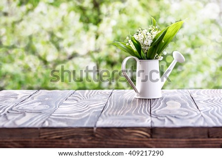 lilies of the valley on a wooden board outdoors