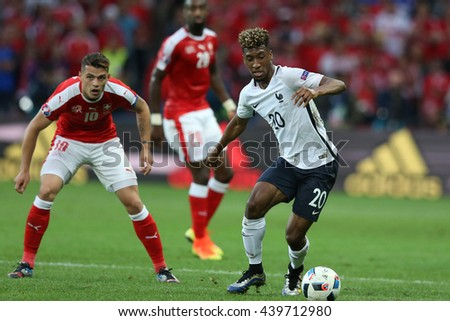 LILLE - FRANCE,  JUNE 2016 : Kingsley Coman  in action during football match  of Euro 2016  in France between  Switzerland and France at the  Stade Pierre Mauroy  on June 17, 2016 in Lille.