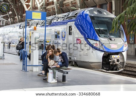 LILLE, FRANCE, on AUGUST 28, 2015. Platforms of the railway station. Trains and passengers.