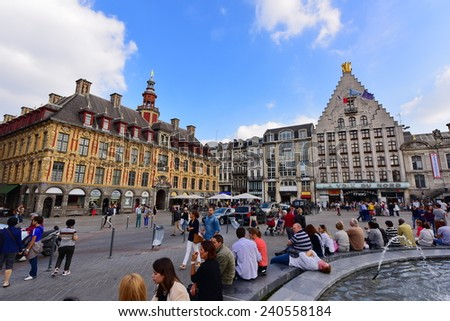 LILLE - SEPTEMBER 13: La Vieille Bourse (old stock exchange building), a remmant of the Spanish occupation on September 13, 2014 in Lille, France - stock photo