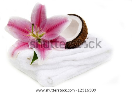 Lilly flower, coco nut and towels - stock photo
