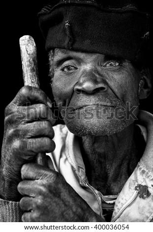 LILONGWE - MALAWI - AUGUST 3, 2015: Unidentified old Malawian man with hat on August 3, 2015 in a village near Lilongwe, Malawi - stock photo