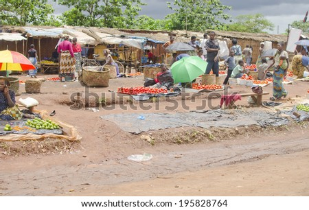 LILONGWE, MALAWI - JANUARY 16: roadside food market on January 16, 2014 in Lilongwe, Malawi. Lilongwe is the capital and largest city in Malawi with a population of 979,000.  - stock photo