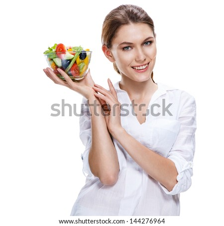 lilt european woman & vegetable salad / attractive girl of the european appearance proposes the vegetable salad in transparent crockery - isolated on white background  - stock photo