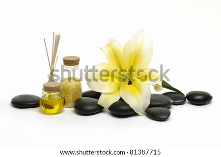 lily flower with stones and bottles of essential oil - stock photo