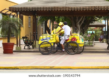 LIMA, PERU - APRIL 19, 2012: Unidentified mobile ice cream vendors with D'Onofrio ice cream carts along Pedro de Osma Avenue in the district of Barranco on April 19, 2012 in Lima, Peru.