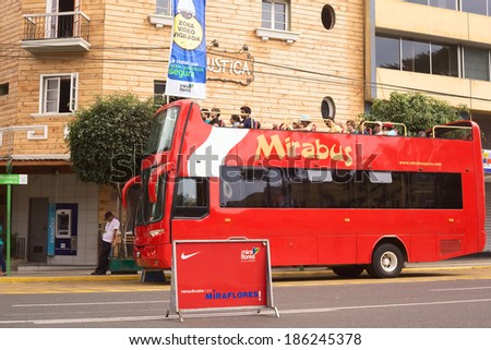 LIMA, PERU - APRIL 1, 2012: Unidentified people on Mirabus sightseeing bus in front of the restaurant Rustica on Av. Diagonal in the touristy district of Miraflores on April 1, 2012 in Lima, Peru.  - stock photo