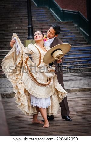 LIMA, PERU - CIRCA 2011: Marinera dancers perform a dance in the street of Barranco town circa 2011, in Lima, Peru. - stock photo