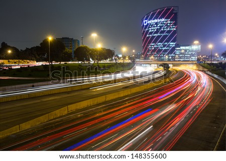 LIMA, PERU - CIRCA 2013: Panoramic view of the Lima express way and the interbank buildind CIRCA  2013 in Lima, Peru. The Lima express way was built in 1969, today is the main free way of the city. - stock photo