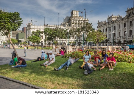 LIMA - PERU, CIRCA 2014: Pedestrians rest under the shade of a tree in the San Martin park  circa 2014, in Lima. - stock photo