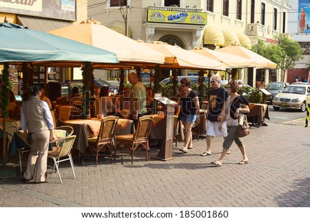 LIMA, PERU - DECEMBER 13, 2011: Unidentified people at the restaurants El Parquetito and El Tigre in the street Calle Lima at the Kennedy Park in Miraflores on December 13, 2011 in Lima, Peru.  - stock photo