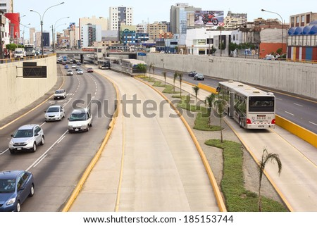 LIMA, PERU - FEBRUARY 13, 2012: Metropolitano bus stop at Avenue Ricardo Palma in Miraflores on February 13, 2012 in Lima, Peru. The Metropolitano is a Bus rapid transit system operating since 2010. - stock photo