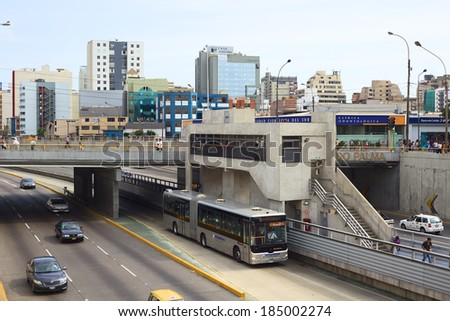 LIMA, PERU - FEBRUARY 13, 2012: Unidentified people at Metropolitano bus stop Ricardo Palma in Miraflores on February 13, 2012 in Lima, Peru. The Metropolitano is a Bus rapid transit system in Lima - stock photo