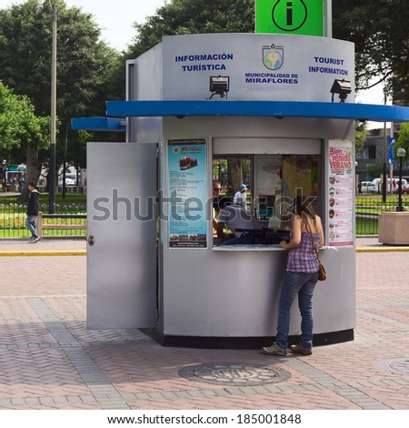 LIMA, PERU - FEBRUARY 11, 2012: Unidentified people at the tourist information at the Kennedy Park in the district of Miraflores on February 11, 2012 in Lima, Peru.  - stock photo