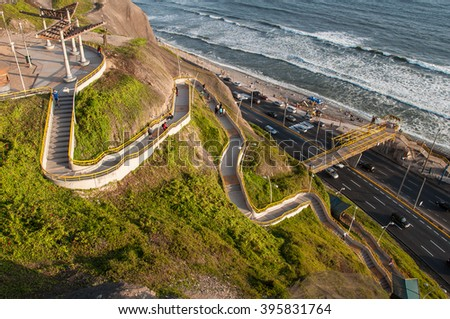 Lima, Peru - MARCH 24, 2016:  Tourists at the stairs to Miraflores beach, documentary editorial.
