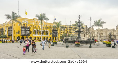 LIMA, PERU, MAY 23, 2014: Plaza Mayor with  the fountain from 1651 in the centerpiece  - stock photo
